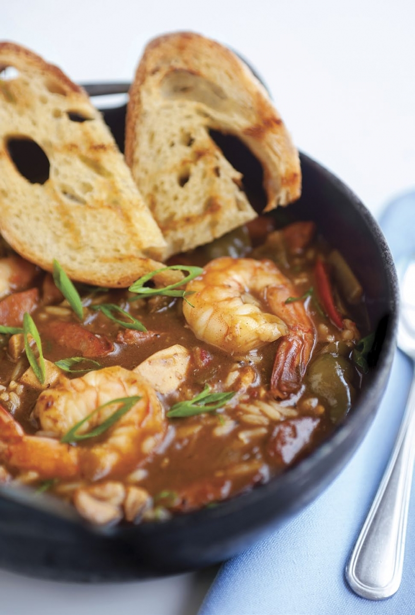 Top: Louisiana gumbo with shrimp, andouille sausage and blackened chicken