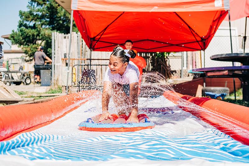 girl playing in water Sacramento Adventure Playground